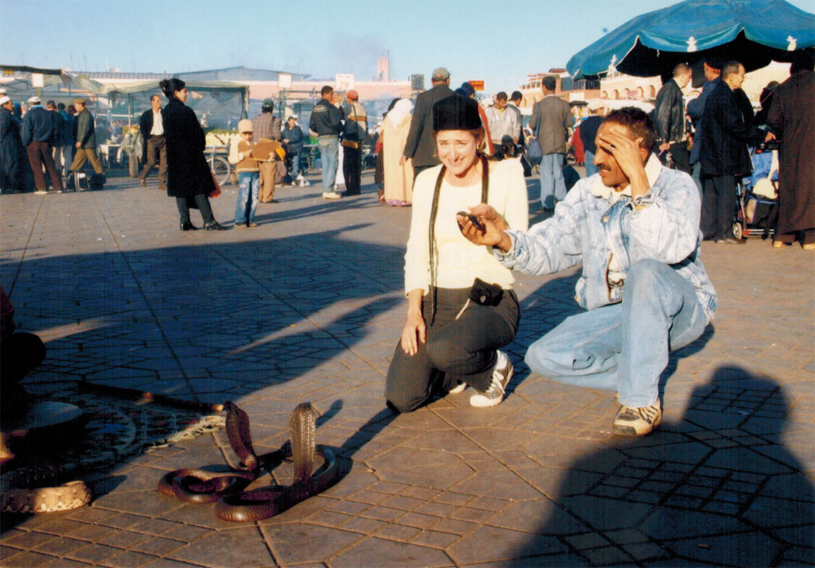 Christi and snake charmer in Marrakech's Jemaa el Fna plaza
