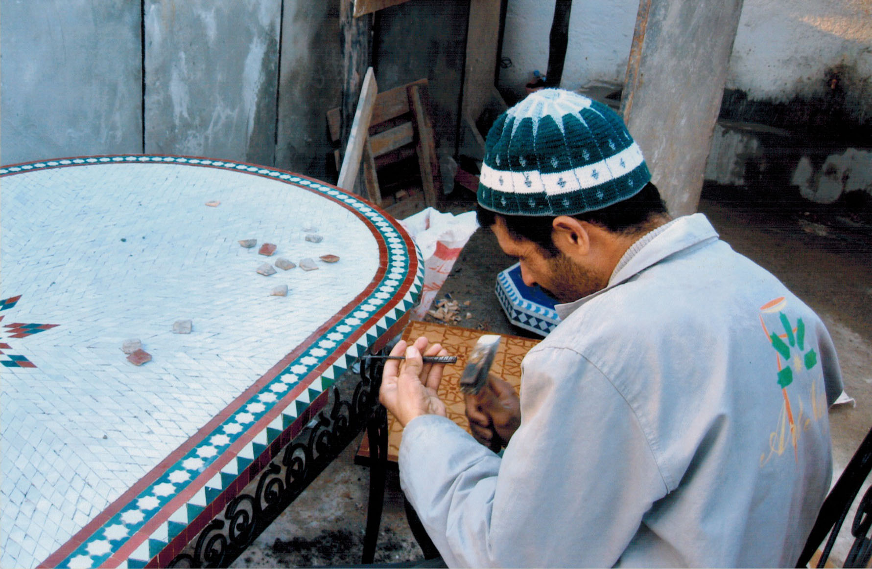 Artisan working in the ceramics factory outside the New Town of Fez, Morocco