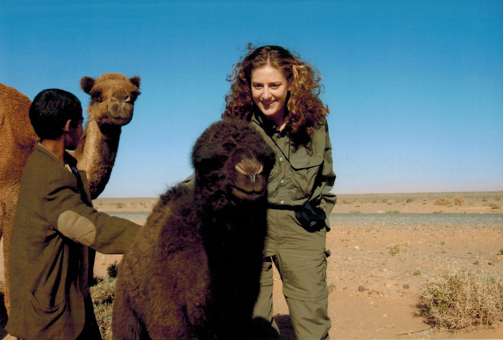 Christi petting a baby camel in Morocco's Berber Country