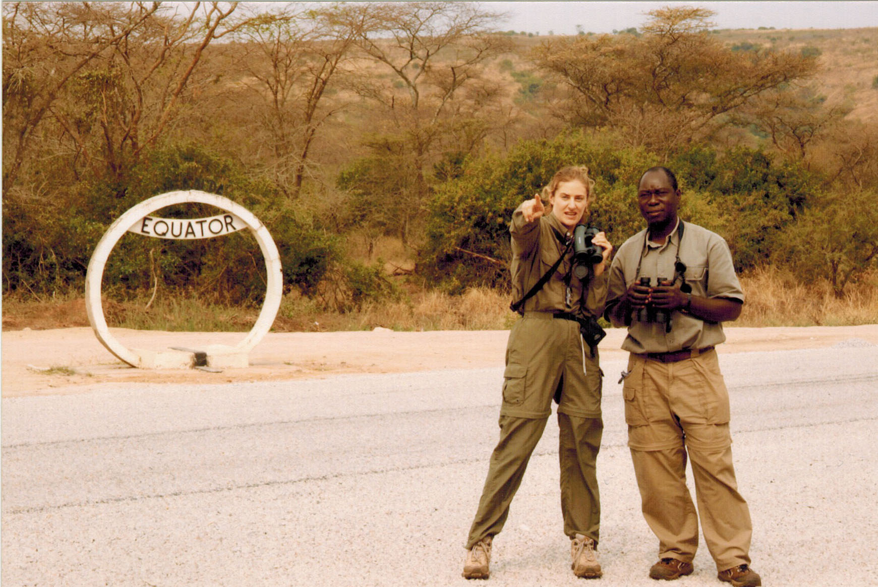 Christi and guide Ben at the Equator in Uganda