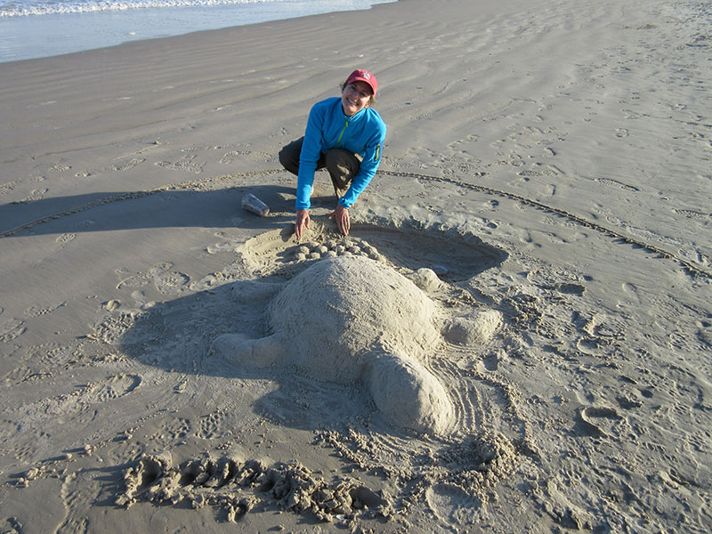 Christi making a sand turtle at Padre Island National Seashore