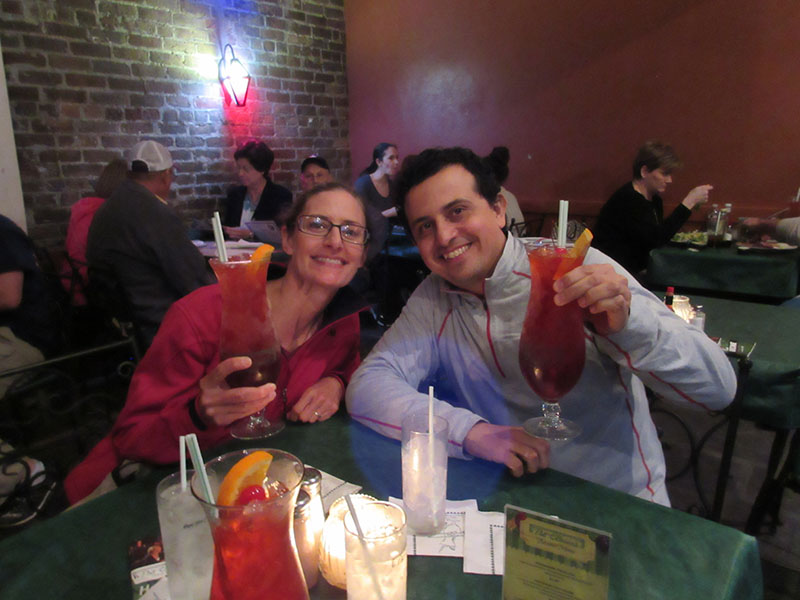Christi & Hector drinking Hurricanes in New Orleans