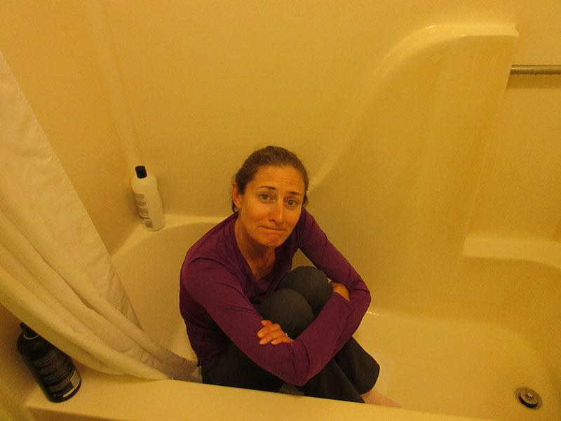 Christi sheltering in the bathroom