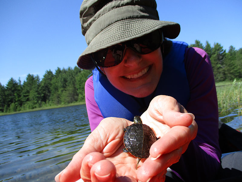 Christi with baby turtle at Kingston Lake State Park