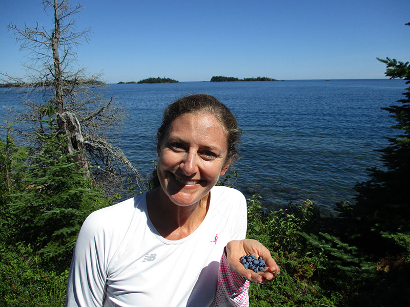 Christi with blueberries on Isle Royale