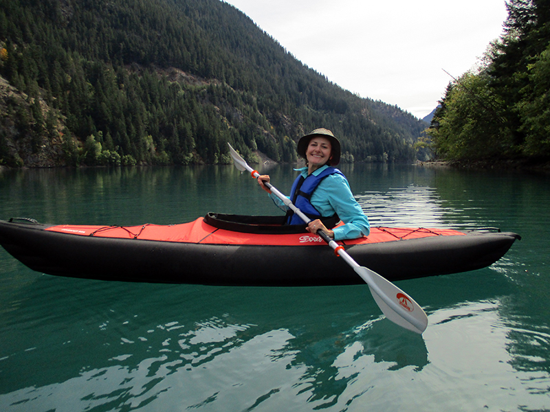 Christi kayaking on Diablo Lake in North Cascades National Park