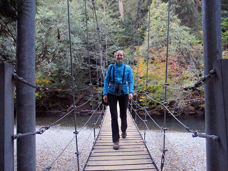 Christi crossing the Ohanapecosh River in Mount Rainier National Park