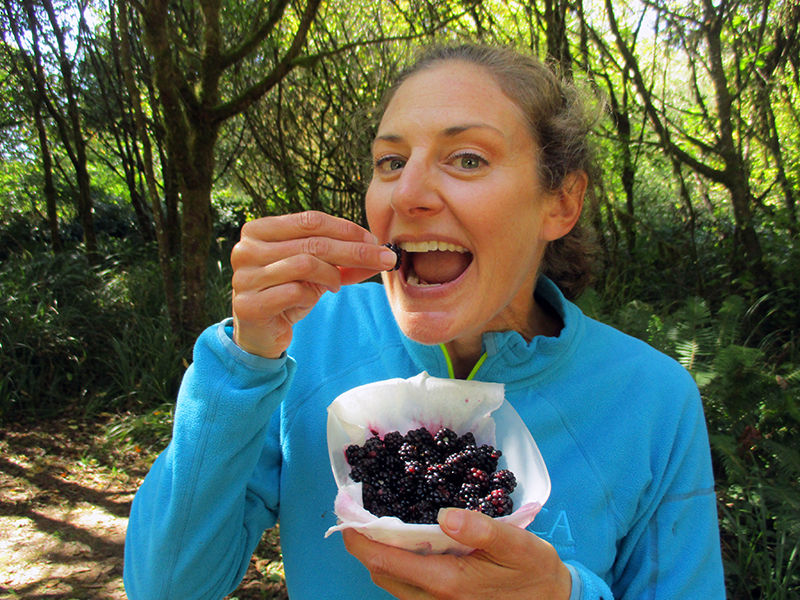 Christi eating blackberries in Elk Prairie Campground