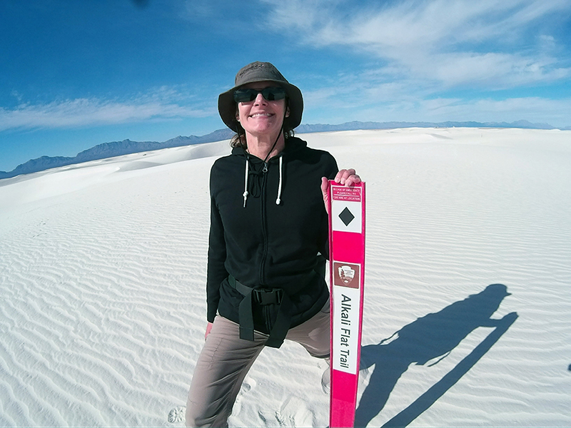 Christi hiking on the Alkali Flat Trail in White Sands National Monument