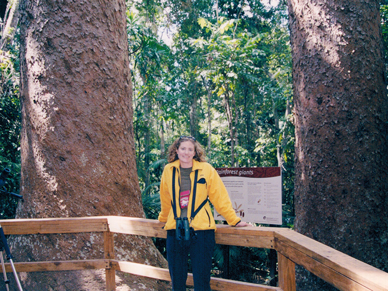 Christi at the Twin Kauri Trees at Lake Barrine National Park