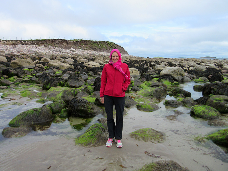 Christi with mossy rocks on an Achill Island beach