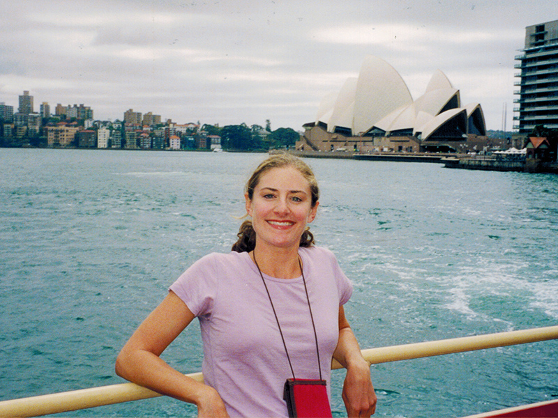 Christi in front of the Sydney Opera House as seen from the harbor